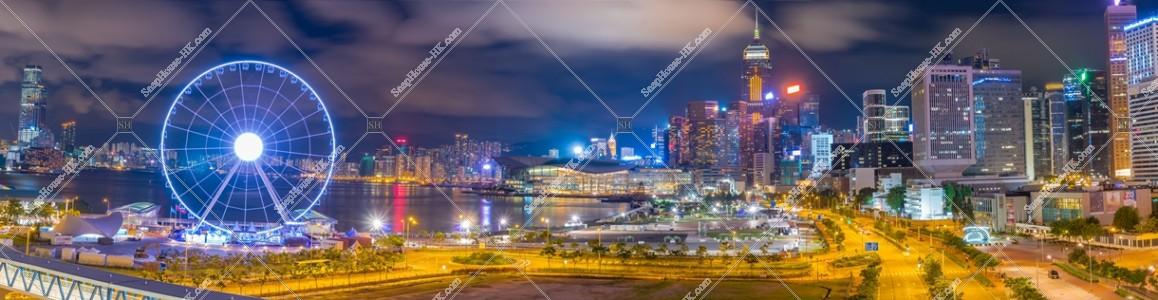 香港観覧車と湾仔(灣仔)の高層ビル群のパノラマ夜景 その①